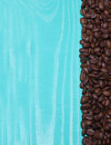 Background turquoise wooden plank with coffee beans stock photo