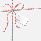 Background with twine lace and white paper gift label Royalty Free Stock Photography