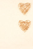 Background with two hearts on gold Stock Image