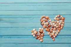 Background with two hearts made of seashells on blue painted woo royalty free stock photos