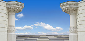 Background with two pillars, paved floor and cloudy blue sky Stock Photography