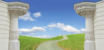Background with two pillars, winding way and cloudy blue sky Stock Photography