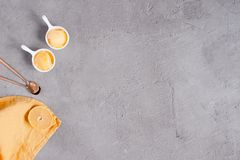 Background with two portions of  lemon sorbet. And yellow napkin, textured grey table. Copy space Stock Image
