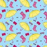 Background of umbrellas, rubber boots, handbags and eyewear. Spring and autumn shoes and accessories. Fashion Royalty Free Stock Image