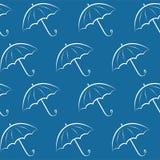 Background with umbrellas. Seamless pattern with umbrellas on blue background Royalty Free Stock Photos