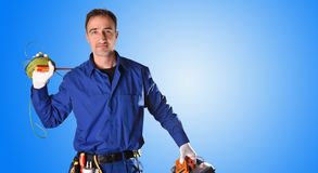 Background uniformed electrician with tools and electrical equipment half body royalty free stock image