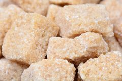 Background of unrefined sugar. Close-up Royalty Free Stock Photos