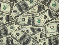 Background of US dollar bills. Background of US one and one hundred dollar bills Stock Image