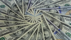 Background with 100 US dollar bills rotate. Seamless Looping Motion stock footage