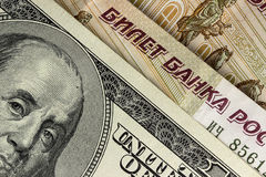 Background of US dollars and Russian rubles, close up Stock Photography