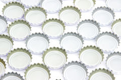 Background of used beer caps. Over white Stock Image