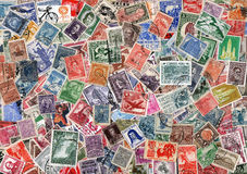 Background of used Latin American postage stamps. Vintage background of old used Cetral and South American postage stamps Royalty Free Stock Photos