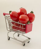 A background on useful food and shopping with cherry tomatoes in Royalty Free Stock Image