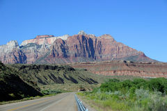 Background - Utah Road-Zion NP. Image suitable as a background image for use in the tourist industry, dept's or transportation, etc.  Specifics: Road in Utah Royalty Free Stock Photography