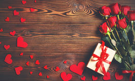 Background Valentine`s Day. heart, gift  and roses on wooden. Background Valentine`s Day. heart, gift  and roses on a wooden background Royalty Free Stock Photo