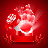 Background for Valentine's Day. Holiday background for Valentine's Day with a gift box in heart shape Stock Photos