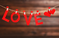 Background Valentine`s day. two red hearts and word Love on wood Stock Photo