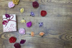 Background for Valentines day concept. Gift box with group of roses over wooden table. Top view with copy space stock photography