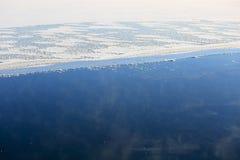 Background of Vaporizing, Freezing Blue Sea Royalty Free Stock Image