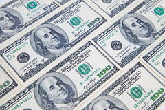 Background from a variety of hundred-dollar bills. Many money. Dollars background. Royalty Free Stock Photo