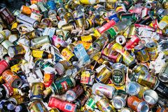 Background of various crashed beer cans and botle royalty free stock images