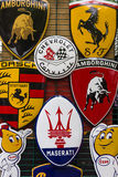 Background of various emblems of various car brands producing sports cars. Stock Image