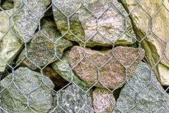 Background various rocks large and small for metal mesh stock photos