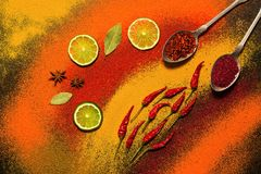 Background of various spices, red, orange, yellow. Paprika, turmeric, anise, bay leaf, chilli pepper, lime, saffron. Assorted spic. Background of various spices royalty free stock image