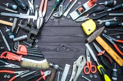 Background from various tools on wooden workbench. top view.copy space royalty free stock photography