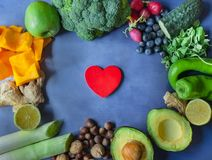 Background of vegetables, fruits and nuts with red wooden heart royalty free stock images