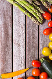 Background vegetables on a wooden background Royalty Free Stock Image
