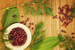 Background for vegetarian menu with beans and greens. Stock Images