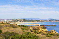 Background view of the city of Lagos in Portugal, dock, cape and the ocean, Royalty Free Stock Photo