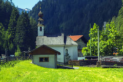 Background view of a small church in a village in Tyrol Royalty Free Stock Image