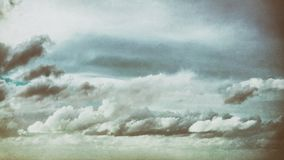 Background of vintage cloudscape. Vintage cloudscape with grungy textures stock photography