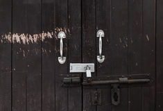 Background of vintage wood locked door with peeling paint and rusty hinge Stock Image