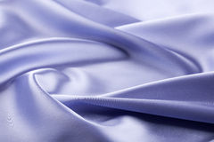 Background of violet silk fabric Stock Images
