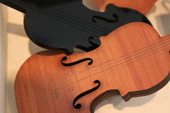 Background violins. Black and brown lighted Stock Image