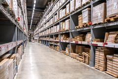 Background of virtual coke in shelves of large cargo warehouses royalty free stock images