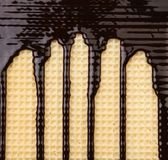 Background of wafer. Stream chocolate. Stock Image