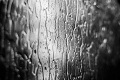 Raindrops on window glass. The raindrops on the glass in rainy weather in the summer Royalty Free Stock Image