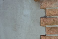 Background of a wall of brick and stone cemented with concret. stock image