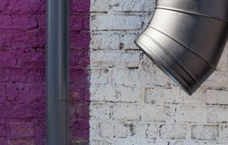 Background wall brick violet white, pipes big and small Royalty Free Stock Photo