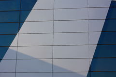 The background wall of the building. The plastic panels. A transparent panel is sea green. Opaque white panel. Stock Images