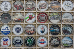 Background of a wall clock with the logos of well-known automotive companies (retro and modern). STUTTGART, GERMANY - MARCH 18, 2016: Background of a wall clock Royalty Free Stock Image