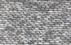 Background - wall decorated with smooth stones Royalty Free Stock Images