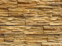 Background the wall facing stone. Background of the terracotta wall facing stone Royalty Free Stock Image