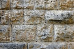 Background of wall of large protruding stones. The background of wall of large protruding stones stock photos