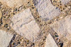 Background wall made of stone. Fragment of a wall from a chipped stone Royalty Free Stock Photo