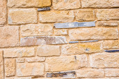 Background wall made of stone. Fragment of a wall from a chipped stone Stock Images